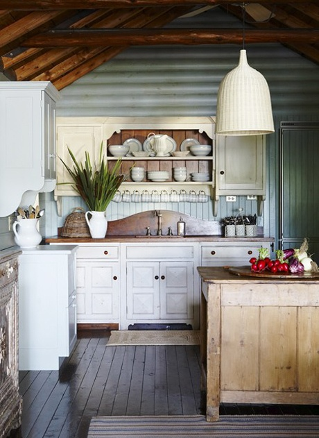 Country kitchen love the tin on the walls and the dresser and wood for the sink