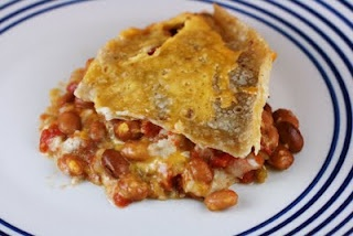 Bean and Cheese Burrito Casserole Slow Cooker Recipe  -- it's Mexican food, and a slow cooker recipe.  Of course, I love this!