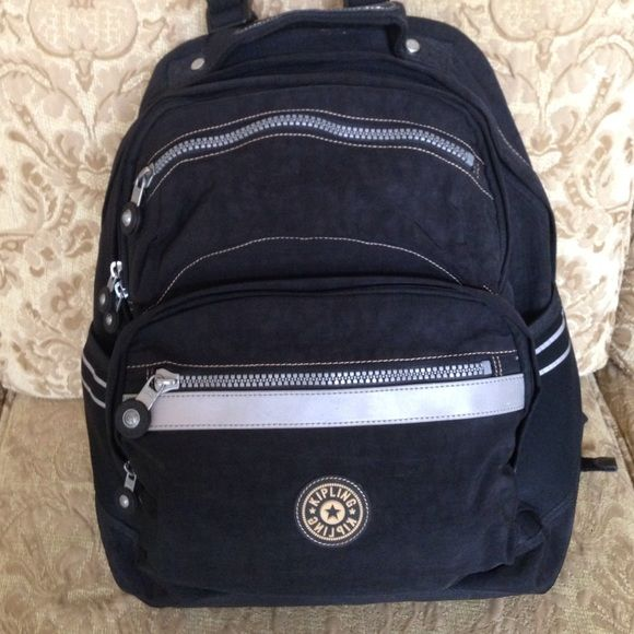 Kipling backpack  Authentic Kipling laptop backpack with plenty of room for work, school materials or travel. There are 5 zippered compartments & 2 side open pockets. Main zippered compartment accommodates a laptop secured with a velcro closure & padded divider separates books/work materials or travel items from the laptop. Gently used. No keychain. No trades.  Kipling Bags Backpacks