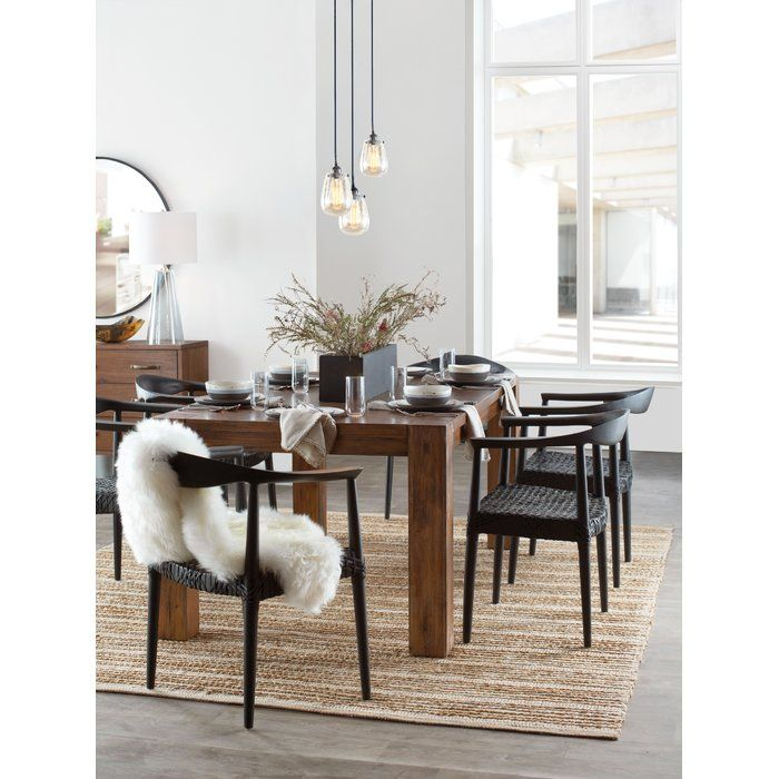 Reminiscent of mid-century modern chairs with blond wood and spindle legs, the retro chic Arvada armchair is updated with intricate woven seat in a contemporary black laced web effect. Made from reclaimed teak, this transitional chair adds character to the living room, family room or perhaps a pair facing a desk.