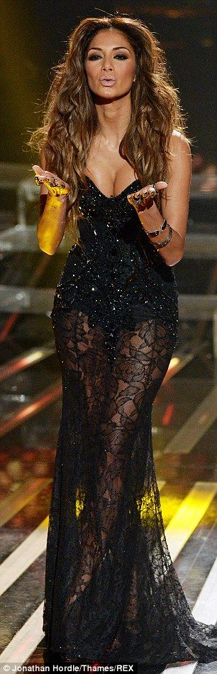 Taking a risk: Nicole showed off her incredible figure in the skimpy dress, which featured sheer black material up to her hips