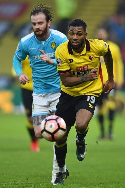Burton Albion's English defender John Brayford (L) vies with Watford's English striker Jerome Sinclair during the English FA Cup third round football match between Watford and Burton Albion at Vicarage Road Stadium in Watford, north of London on January 7, 2017. / AFP / Glyn KIRK / RESTRICTED TO EDITORIAL USE. No use with unauthorized audio, video, data, fixture lists, club/league logos or 'live' services. Online in-match use limited to 75 images, no video emulation. No use in betting…