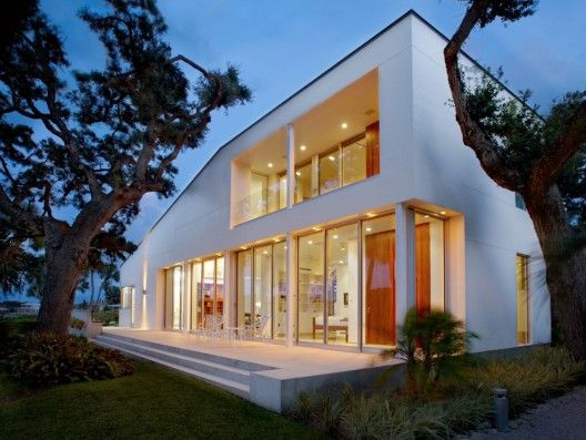 Looking to add warmth to your modern residential space? This Barrier Island House by Sanders Pace Architecture uses dark brick and cedar as secondary materials cladding accessory volumes and surfaces while an abundance of glass lends transparency to the primary public spaces.