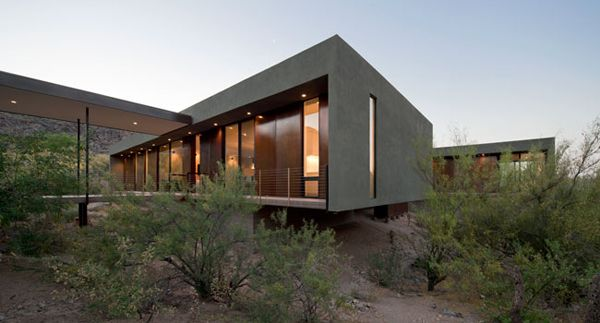 Modern vacation house suspended above the desert.