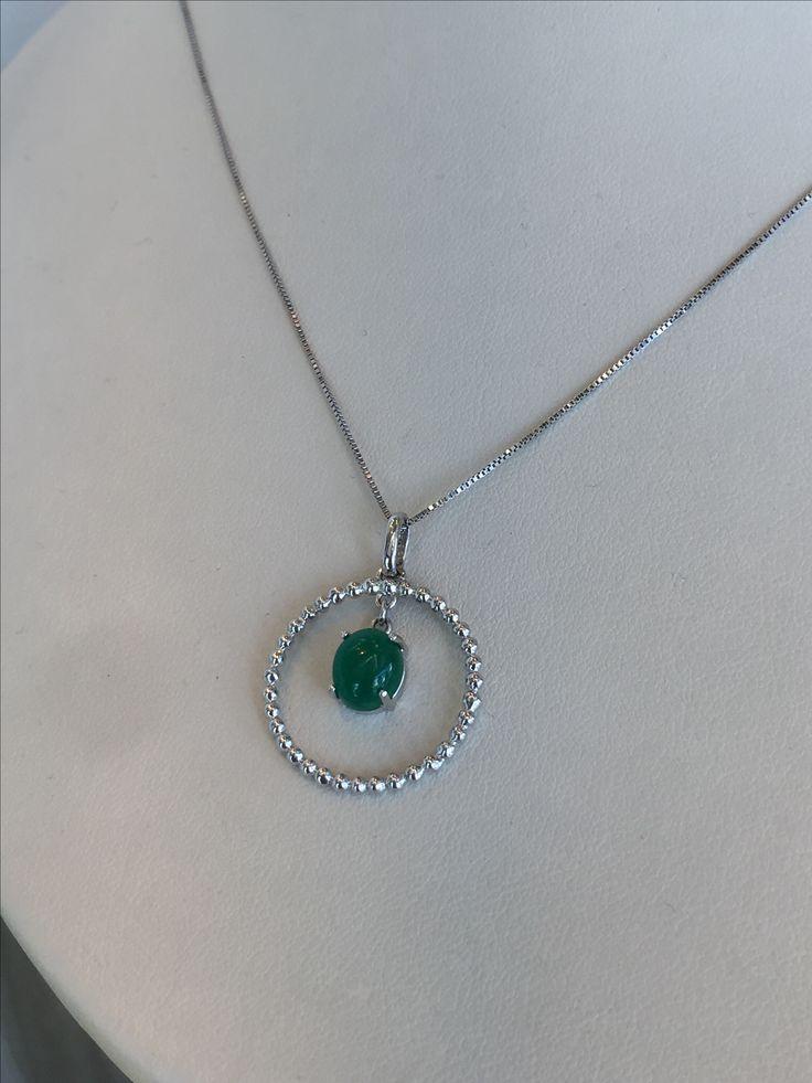 Pendiente con esmeraldas y diamantes