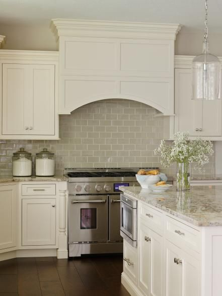The design experts at HGTV.com share photos of a beautiful, traditional white kitchen with adjacent breakfast nook, designed by Bria Hammel.