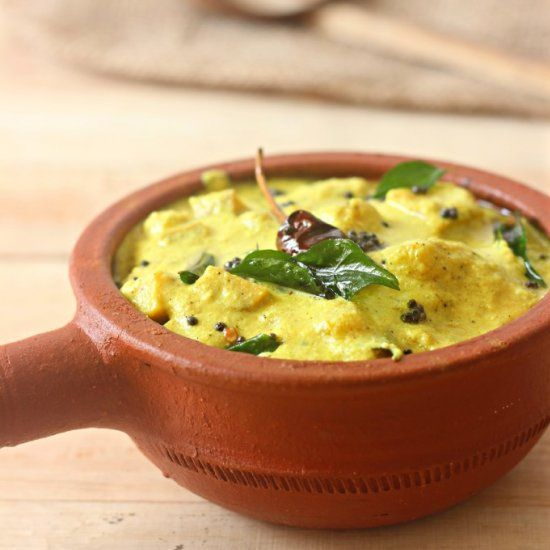 Kaalan- Raw Banana and Yam cooked in coconut and yogurt based Gravy served on Onam Sadya.