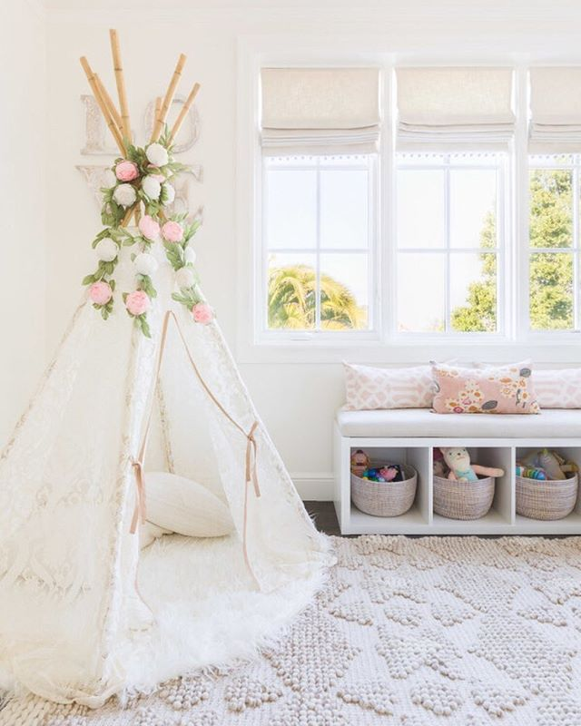 why weren't flower-adorned teepees an interior décor trend when we were kids?!  this beautifully decorated room spotted on @smpliving might be the dreamiest kids' corner we've ever seen. {double tap if you agree} photography: @alyssarosenheck, design: @amandabarnesinteriors