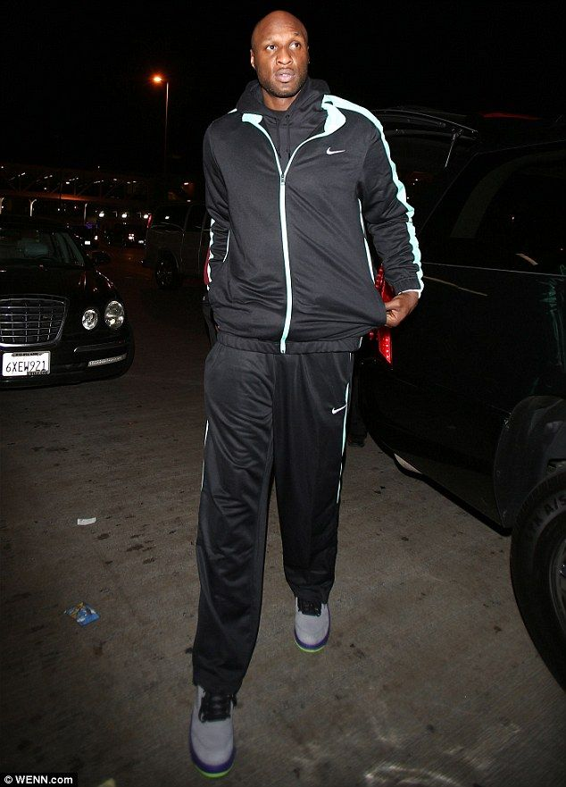 'Doing better': Lamar Odom, pictured here in 2013, is said to be walking with assistance a...