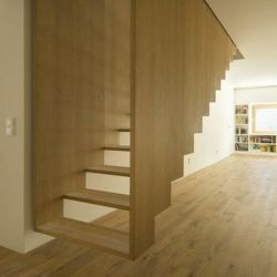 Haus MuUGN in Memmingen, Germany by SoHo Architektur. A contemporary house encased in archetypal dark wood.