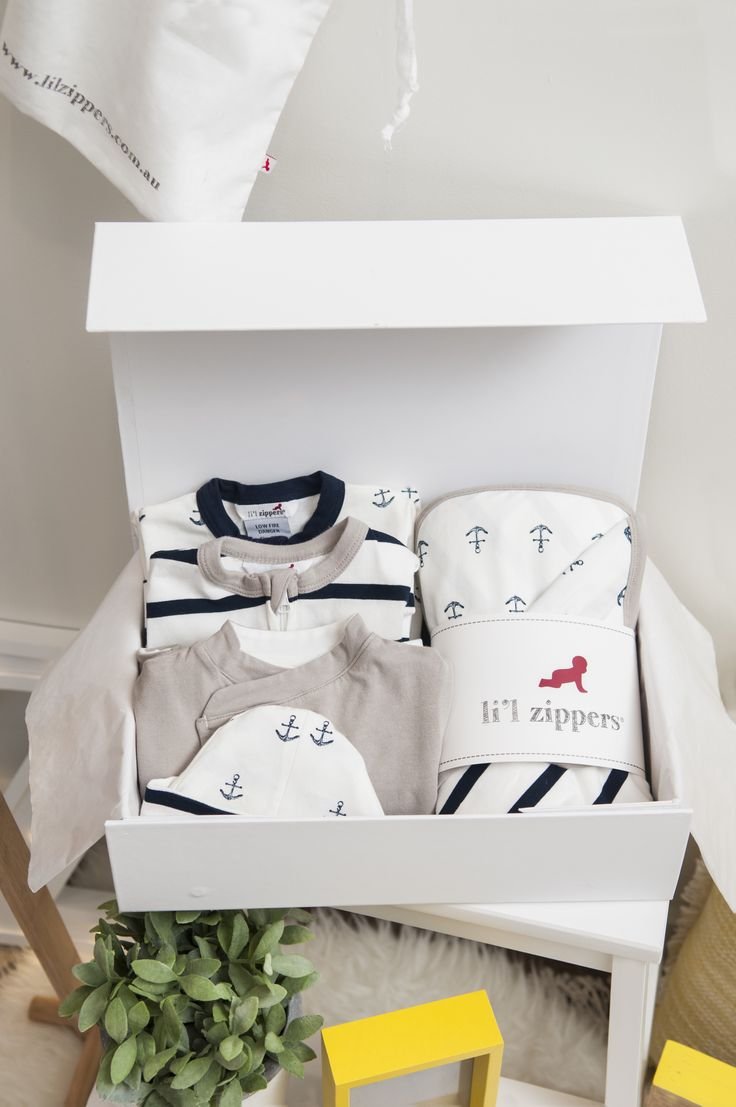 Li'l Zipers: Baby Gift Hamper Navy What's Included: 1 stripe romper 1 anchor romper 1 reversible jacket 1 double sided blanket 2 reversible beanies 1 gift box (per size)