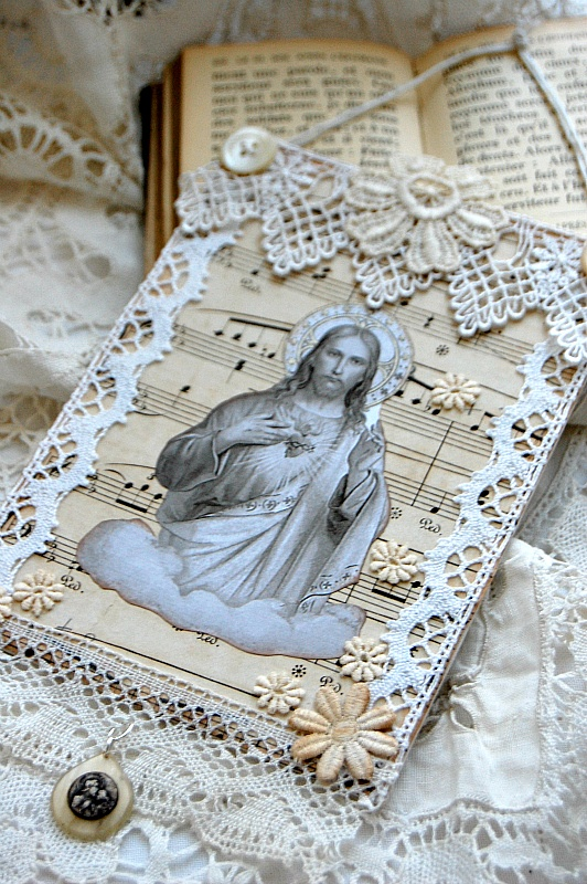 Religious collage wall hanging, handcrafted on small canvas board with vintage lace, flowers, buttons, and medal