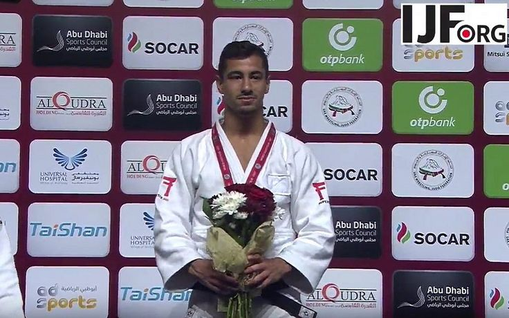 Tal Flicker and bronze-winner Gili Cohen forced to celebrate under international judo federation's banner due to local prohibition on Israeli symbols