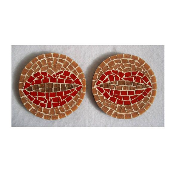Circular mosaic coaster with a wooden base. The coaster has a 4 inch radius. The wood was painted with a protective finish before tiling and grouting. The tiles have been sealed and the back is painted with an acrylic black paint. Please allow us 1-2 business days to ship.