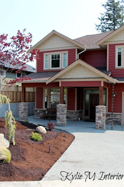 house exterior countrylane red hardiboard with beige windows, dark beige trim, fascia and gables with stacked stone detail and oak front door