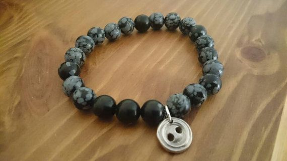 Check out this item in my Etsy shop https://www.etsy.com/uk/listing/385198818/obsidian-button-bracelet-button-charm