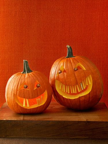 funny pumpkin carving ideas jack o lanterns womans day toothy grins - Funny Halloween Pumpkin Carvings