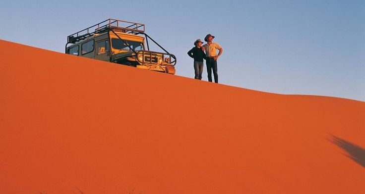 An adventure together - look at that amazing red sand!  Australia!