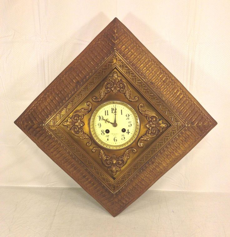 antique paris jeweler wall clock gold colored tin case porcelain face with pendulum runs and strikes france