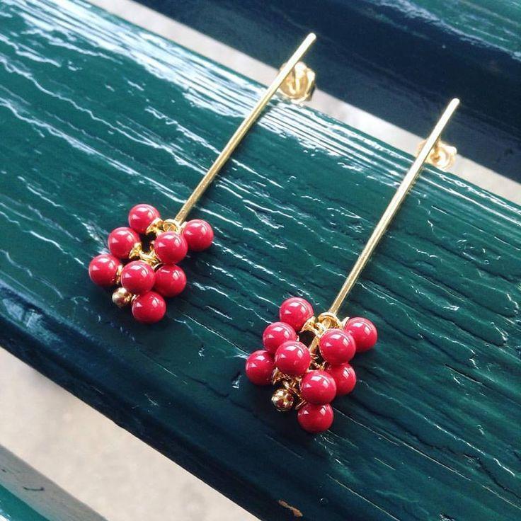Raspberry earrings.