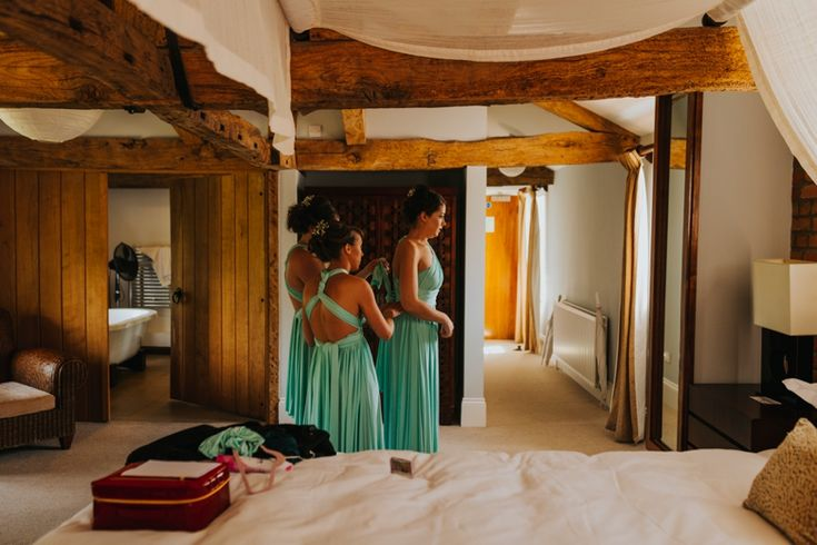 The girls helping each other to style their dresses in the bridal suite at @wasingpark, Berkshire, UK. Photo by Benjamin Stuart Photography #weddingphotography #bridesmaids #mintgreendress #wasingpark #weddingprep