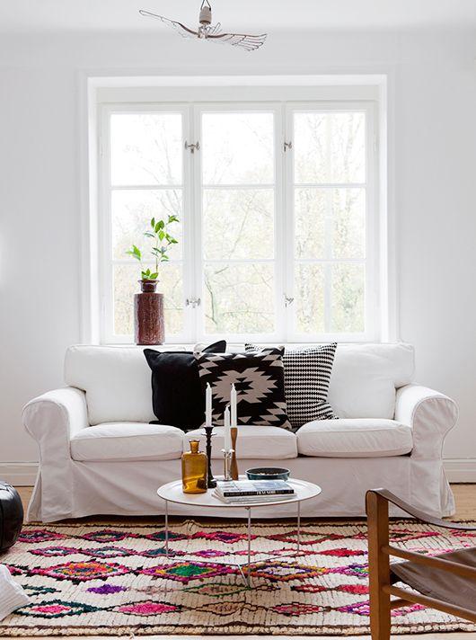 white sofa + bold rug