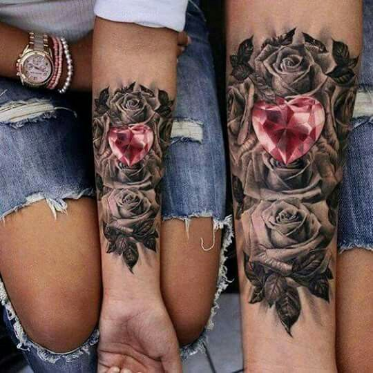 Grayscale roses with pink heart shaped jewel.