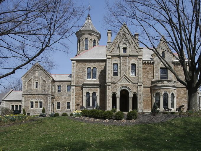 Cool Homes: Probasco mansion in Clifton fit for royalty. Photo: Architect William Tinsley located Oakwood, Henry Probasco's Clifton mansion, on an east-west running ridge and faced it south toward the sun. An iron-gated fence on Lafayette Avenue opened to a road that led up to the mansion before the 29-acre estate was subdivided in the 20th century. The Enquirer/Gary Landers