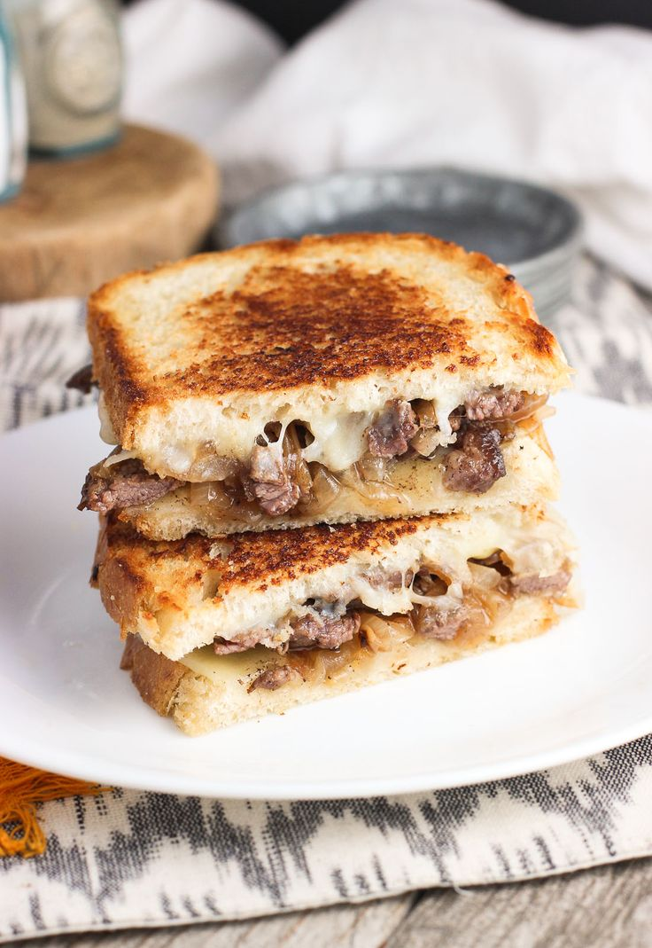 This Philly Cheesesteak Panini is piled high with thinly-sliced beef, provolone cheese, and plenty of caramelized onions.