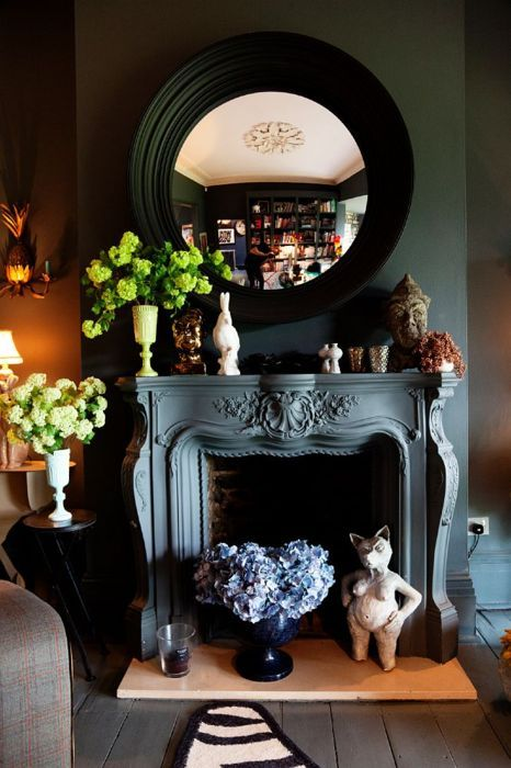 Likes: Circular Mirror, Matching Wall And Fireplace, Tiered Floral Design  Room Design Decorating Designs Interior