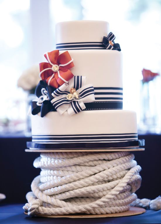Love the ribbons and flowers!    Nautical wedding cake by Bobette & Belle. Photography courtesy of 5ive15teen Photo Company.