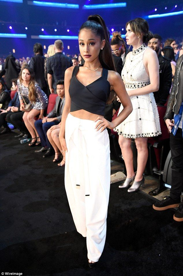 Simply chic: The popstrel rocked slouchy white trousers and a black crop top ...