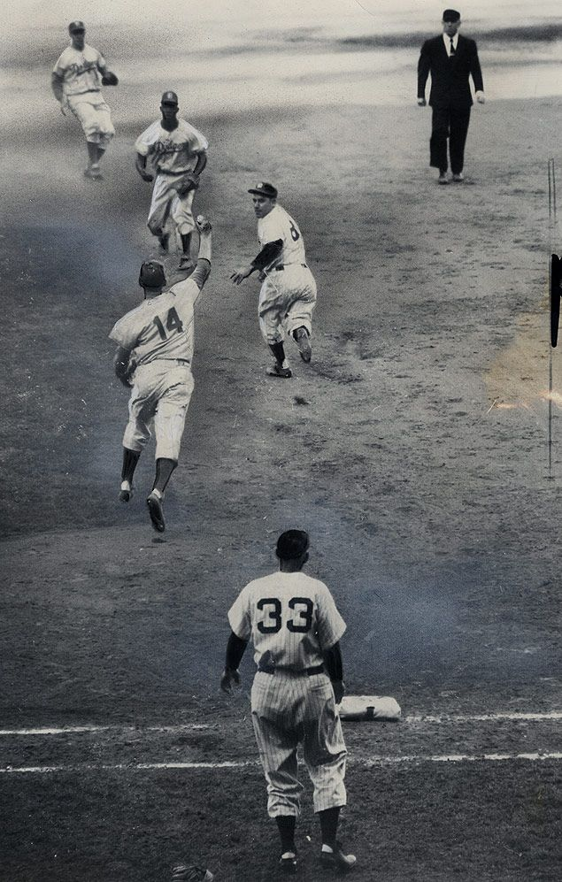 Yogi Berra caught in a rundown during the 1953 World Series.  New York. October 2, 1953. [635x997]