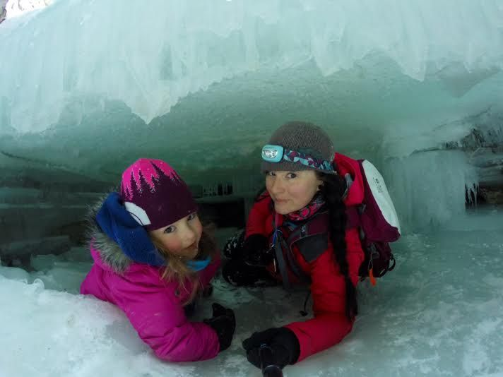 Mother and Daughter Exploring Ice Caves