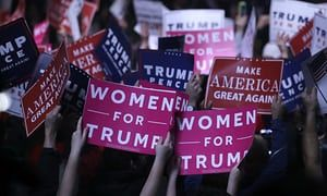 Supporters hold 'Women for Trump' signs before a campaign rally for the presidential candidate on 7 November 2016, in Manchester, New Hampshire.