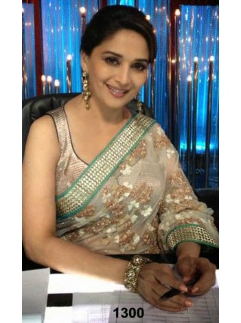 Madhuri Dixit ivory color saree at jhalak Flat 300/- OFF and Special discounts still applicable. Buy now. We ship worldwide. http://20offers.com/deal_of_the_day