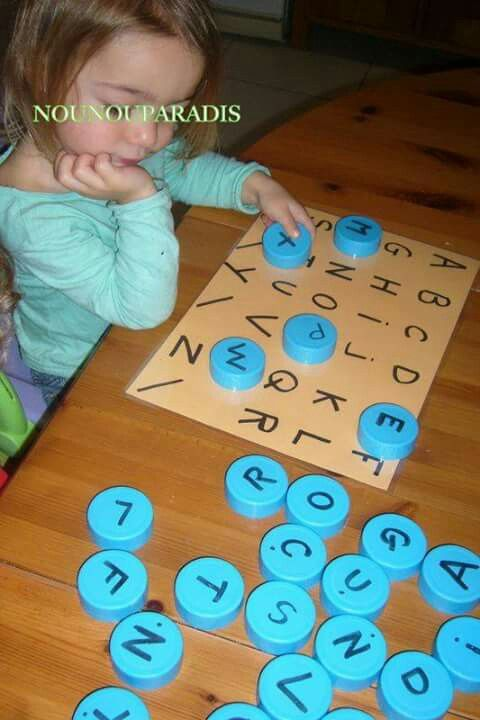 Take 26 of the same caps. Place a letter of the alphabet on each cap. Then make a list of the alphabet on a paper and plasticize it. Give d …