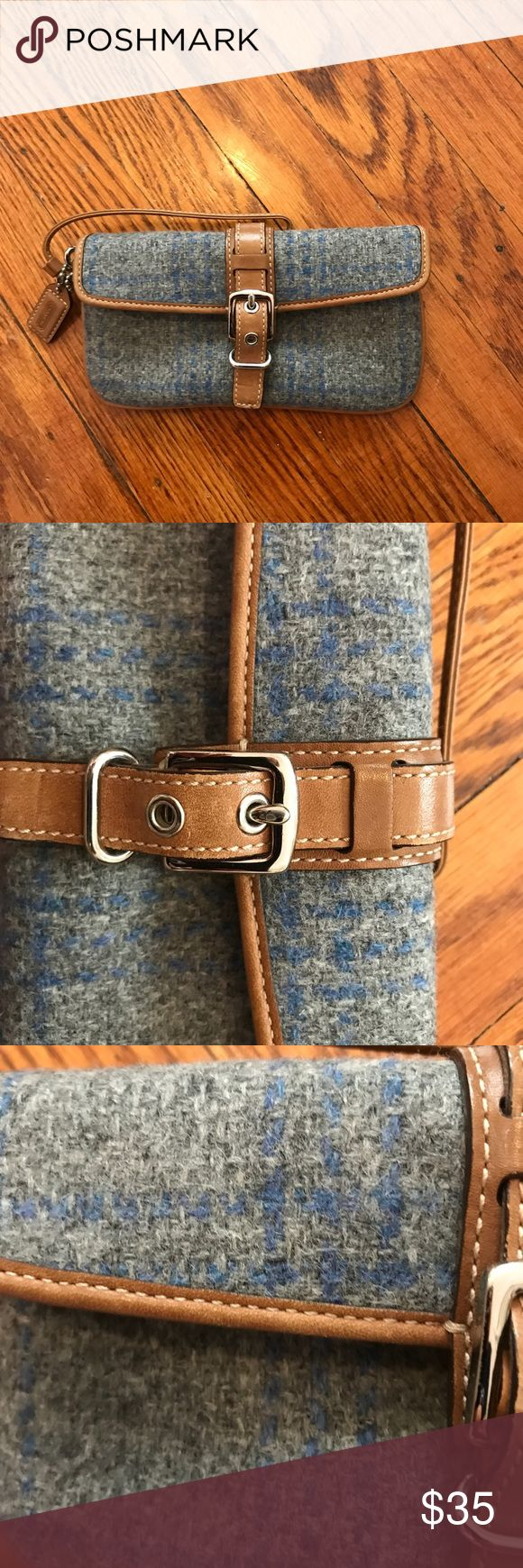 Coach Wristlet Blue wool with tan leather Coach Wristlet light blue wool with tan leather - in great condition- had a clasp to close - never worn- length  is 7 3/4 inches and height is 4 inches  depth is 3inches Coach Bags Clutches & Wristlets