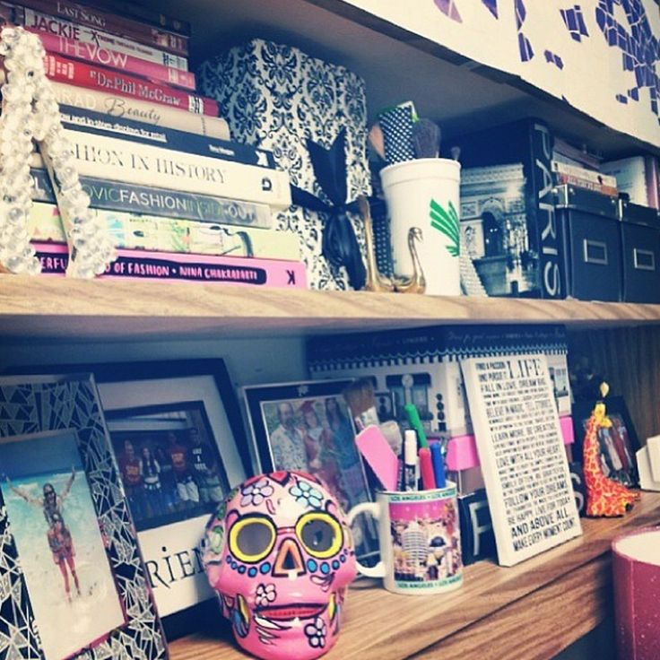 Love how this student dormified their shelf space! All the frames, books, and accessories are a good way to make the space more you!