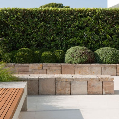 Mosman Landscape by Secret Gardens of Sydney via Houzz Sandstone sitting wall, raised garden bed, garden bench seat