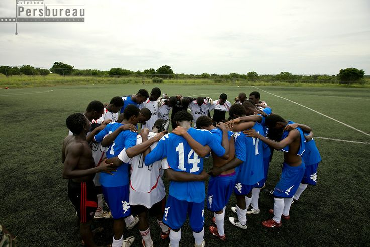 Feyenoord Football School in Fetteh, the players pray together after the match. Ghana.