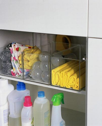 Clear caddies for kitchen cupboard storage -- organization at its finest! | flickr.com Photo from decorology