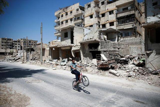 Rubble of damaged buildings at Ain Tarma eastern Damascus