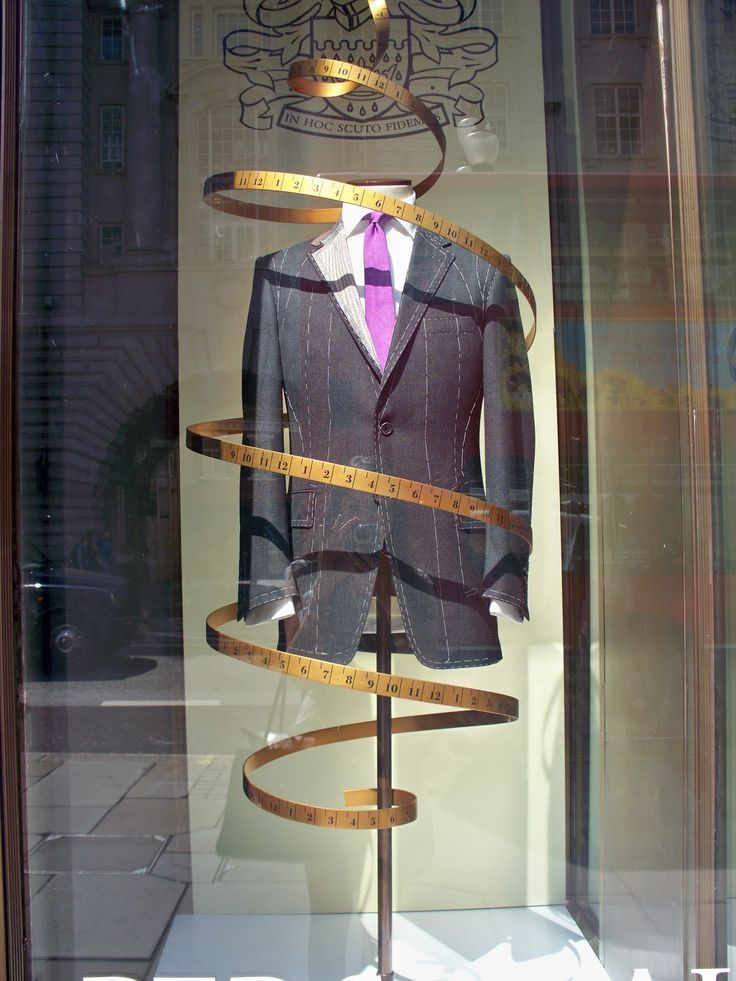 """""""Our Suits are Bespoke Tailor-Made', pinned by Ton van der Veer"""