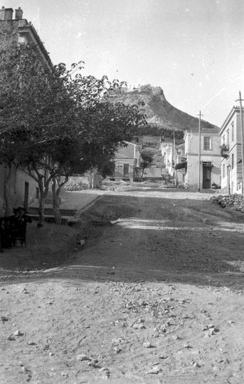 1908 ~ Ploutarchou street in Kolonaki, Athens. Lycabettus Hill in the back
