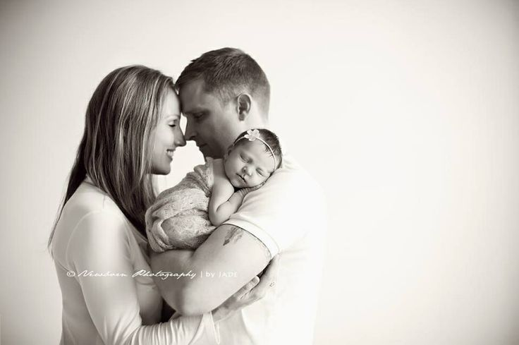 Newborn photography Like this family pose I would like the picture more if the bow or the blanket on the baby was in color