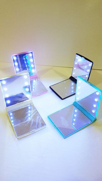compact mirror with led light.  bring your vanity mirror wherever you go.  See your beautiful face in any light.