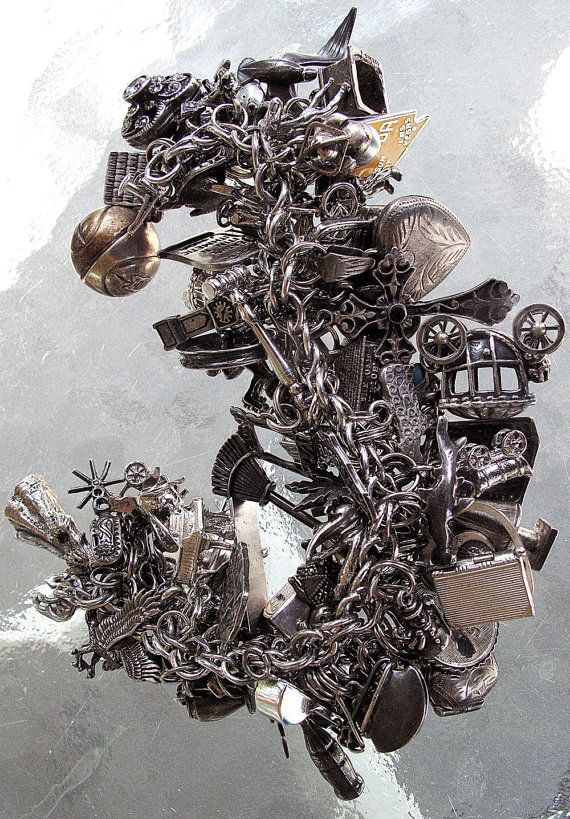 Antique Vintage Sterling Charm Bracelet with 100 Charms.  I love loaded bracelets like this!