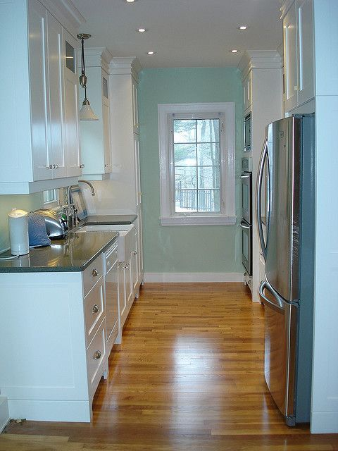 galley kitchen - lighting, floors, crown molding.