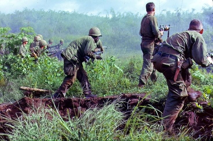 """"""" Dak To, South Vietnam. An infantry patrol moves up to assault the last Viet Cong position after an attempted overrun of the artillery position by the Viet Cong during Operation Hawthorne. """" 1966"""